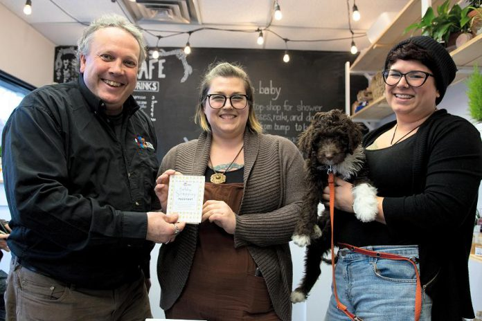 DBIA executive director Terry Guiel and owners Jennifer Avis and Stephanie Hayes of Hello, Baby!, where the winning Holiday Shopping Passport belonging to Avis Moores of Omemee was drawn on January 9, 2019. Moores will receive $1,500 in downtown money that she can redeem at participating businesses in downtown Peterborough. (Photo courtesy of Peterborough DBIA)