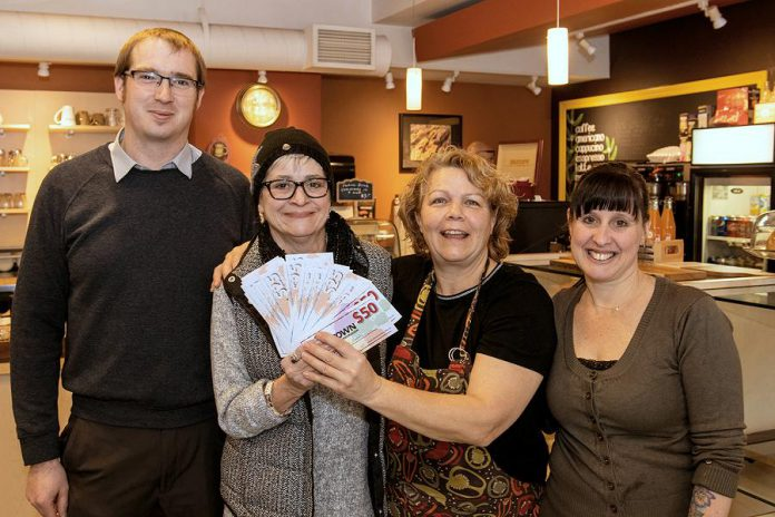 Avis Moores of Omemee (second from left) won the grand prize for Downtown Peterborough's annual Holiday Shopping Passport program and picked up her prize of $1,500 in downtown money on January 11 at Simply Delicious at 197 Charlotte Street. Also pictured are Joel Wiebe of the Peterborough DBIA and Anita Morris and Barb Collins. (Photo courtesy of Peterborough DBIA)