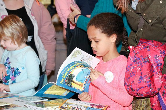 One of the most popular draws of the annual Peterborough Family Literacy Day event is the free book giveaway. That will be the case again on Saturday, January 26, 2019, 9 a.m. to noon, at Peterborough Square as the event is staged for a 20th year, organized by a number of community literacy-related organizations in conjunction with the two local school boards.   (Photo: Peter Rellinger)