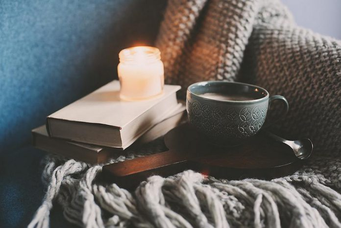 Hygge can include getting cozy with a book, a blanket, and a hot drink while creating a warm atmosphere with candles. Beeswax candles burn cleaner than other choices, and do not release irritating toxins or fragrances that paraffin candles can contain.