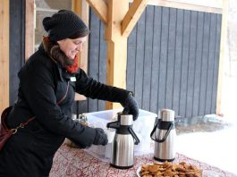 """The Danish concept of """"hygge"""" (pronounced """"hue-gah"""") is about embracing the coziness of the winter season, which can include cuddling up with a blanket and a hot drink at home or heading outside to enjoy nature. GreenUP's Lindsay Stroud combines both at GreenUP Ecology Park with some treats of warm cider and homemade cookies. (Photo: Karen Halley)"""