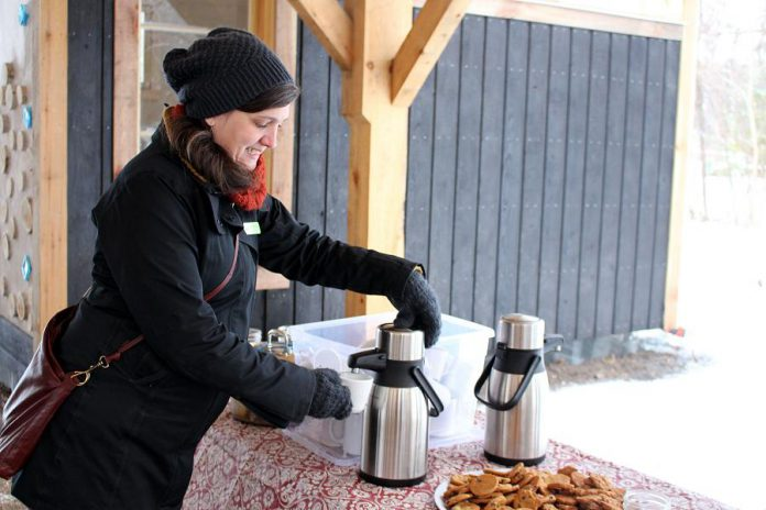 "The Danish concept of ""hygge"" (pronounced ""hue-gah"") is about embracing the coziness of the winter season, which can include cuddling up with a blanket and a hot drink at home or heading outside to enjoy nature. GreenUP's Lindsay Stroud combines both at GreenUP Ecology Park with some treats of warm cider and homemade cookies. (Photo: Karen Halley)"