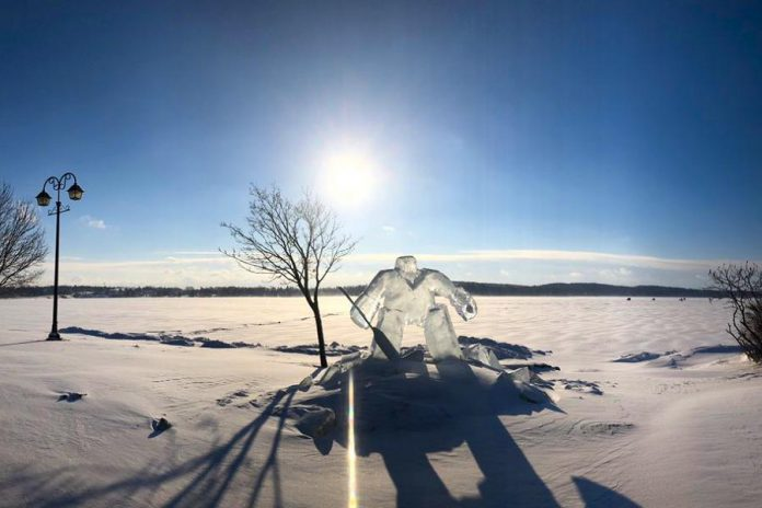 "This ice sculpture of a hockey player by Charlie ""Woodchuk"" Andolsek on the shores of Chemong Lake in Ennismore was created in advance of the annual PolarFest winter family festival in Selwyn Township. The festival runs from February 1 to 3, 2019 and culminates with the annual BEL Rotary Polar Plunge fundraiser, with the theme ""Hockey Plunge in Canada"". (Photo courtesy of Steph Bush / @s0_fetchh on Twitter)"