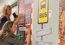 Art School of Peterborough exeutive director Jenni Johnston and volunteer Lori work on a mural in the C3 inpatient unit of Peterborough Regional Health Centre (PRHC). Last fall, a team of 16 volunteers with the art school painted for three days per week over two months to create the murals. (Screenshot from PRHC video)