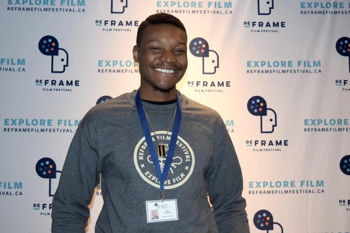 "The annual ReFrame Film Festival wouldn't happen without the passion and dedication of volunteers like Mbongeni ""Mbo"" Mtetwa. Not only is Mbo the vice-chair of ReFrame's Board, but he has also volunteered on the Collective for four years and worked as a festival coordinator for a year. He has been a projectionist for the festival at Market Hall for his entire five years with the festival. This year's festival runs from January 24 to 27, 2019 in downtown Peterborough. (Photo courtesy of ReFrame)"