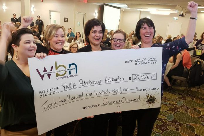 Danielle McIver (left) and Lori McKee (right) of the Women's Business Network of Peterborough celebrate the organization's donation of $22,486.15 to YWCA Peterborough Haliburton with Donna Masters (second from left) and Ria Nicholson (second from right) at the Holiday Inn in downtown Peterborough on January 9, 2019. (Photo: Jeannine Taylor / kawarthaNOW.com)