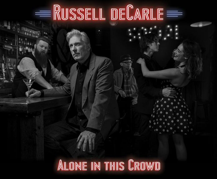 "Russell deCarle's latest solo effort is ""Alone In This Crowd""."