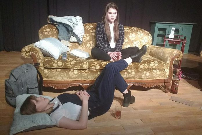 "Despite her television career, Anwen O'Driscoll continues to appear on the stage at Lindsay Little Theatre. Here she is pictured (on the couch) in the Lindsay Little Theatre production of Clare McIntyre's feminist play ""My Heart's A Suitcase"" in May 2018. Also pictured is Anwen's sister, artist and actress Ilan O'Driscoll. (Photo: Sam Tweedle / kawarthaNOW.com)"