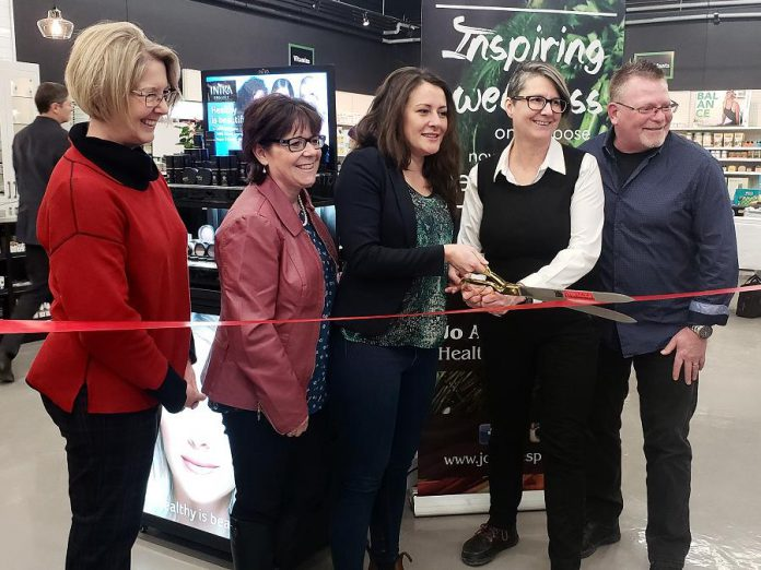 Peterborough mayor Diane Therrien (middle) cuts the ribbon for the official opening of the renovated Jo Anne's Place health food store at 1260 Lansdowne Street West in Peterborough. Also pictured (left to right) are city councillors Kim Zippel and Lesley Parnell and Jo Anne's Place owners Margo and Paul Hudson. (Photo: Jeannine Taylor / kawarthaNOW.com)