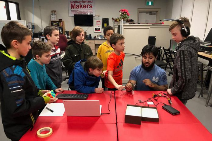 Alex Papanicolaou of Hardware Solutions, a member of and the lead designer for the Microfactory Co-operative in Cobourg, mentoring youth makers at the Northumberland Makers space at Venture13.  The Microfactory Co-operative is one of 45 tech start-ups in eastern Ontario that are receiving seed funding from Northumberland Community Futures Development Corporation's N1M program, which was recently expanded with FedDev Ontario funding. (Photo:  The Microfactory Co-operative)
