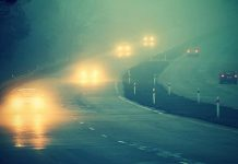 Cars on highway in fog