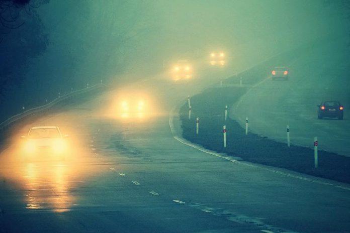 Cars on highway in fog