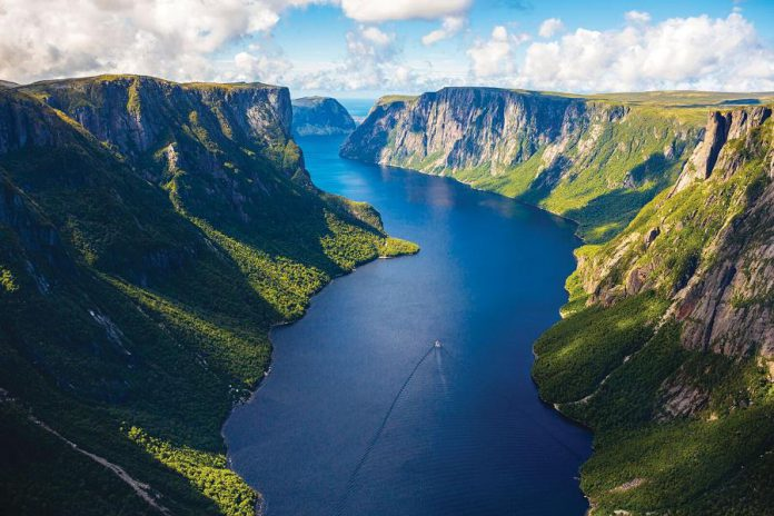 """Dubbed the """"Jewel of Newfoundland,"""" Gros Morne is located on the west coast of Newfoundland and is a UNESCO World Heritage Site. The area is known for its stunning views, particularly from Western Brook Pond, where a three-kilometre trail leads to an inland fiord with cliffs that ascent 600 metres from the water. (Photo courtesy of Barrett & Mackay Photography)"""
