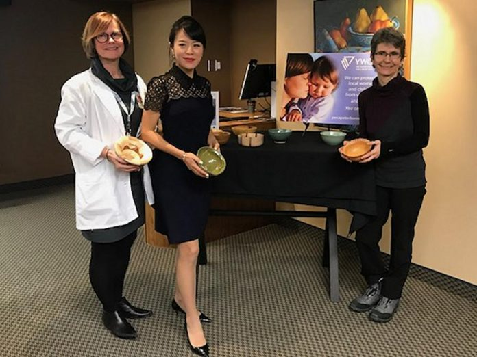 Jane White (registered nurse with Kawartha Cardiology Clinic), Dr. Anna Jo (owner of Cornerstone Family Dentistry), and Joëlle Favreau (Manager of the Nourish project with YWCA Peterborough Haliburton) at the announcement of the 2019  Empty Bowls fundraiser taking place on Friday, March 1.  Kawartha Cardiology Clinic is the title sponsor and Cornerstone Family Dentistry is the to-go sponsor of this year's event. (Photo courtesy of YWCA Peterborough Haliburton)