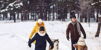 A family going for a winter walk outdoors