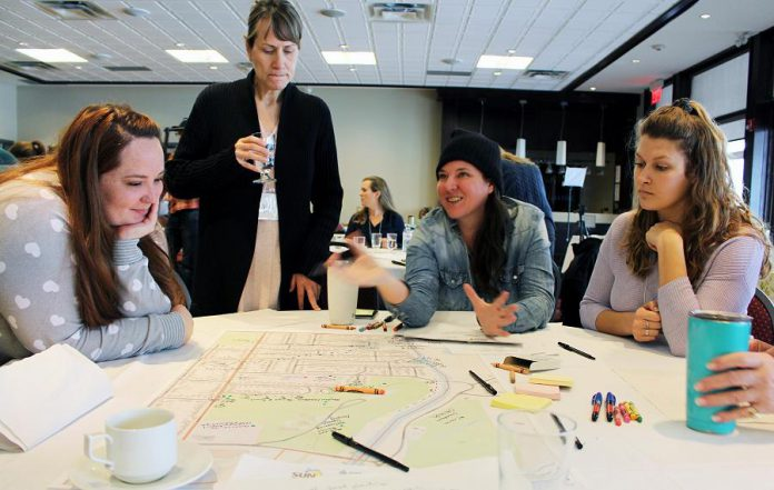 On January 23rd, municipal staff members, community partners, and 45 Peterborough residents attended an action plan gathering organized by GreenUP's Sustainable Urban Neighbourhoods (SUN) program.  Here, participants share their ideas for the East City–Curtis Creek SUN Action Plan. (Photo: Karen Halley / GreenUP)