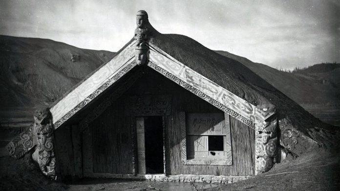 Maori meeting house Hinemihi after the eruption of Mount Tarawera in New Zealand in 1886. The building, which sheltered  Victoria Hunt's ancestors during the eruption, was dismantled and transported to England five years later. (Photo: A A Ryan / Hinemihi Collection)