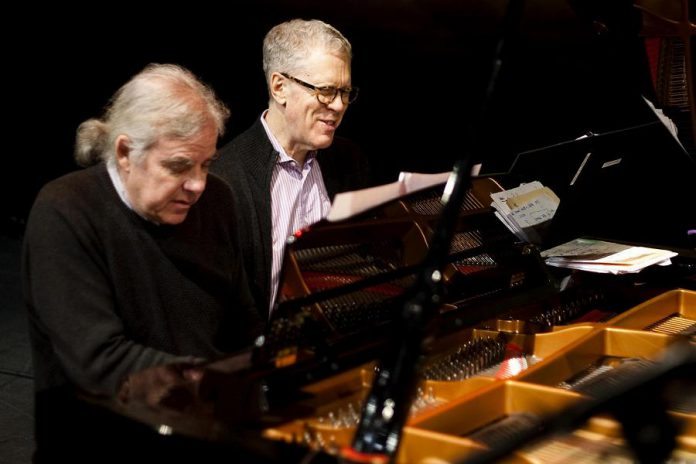 Russell deCarle will also be joined by pianist John Sheard, pictured here with the late Stuart McLean. Sheard was the music director and pianist for McLean's long-running CBC radio show The Vinyl Cafe. (Photo courtesy of John Sheard)