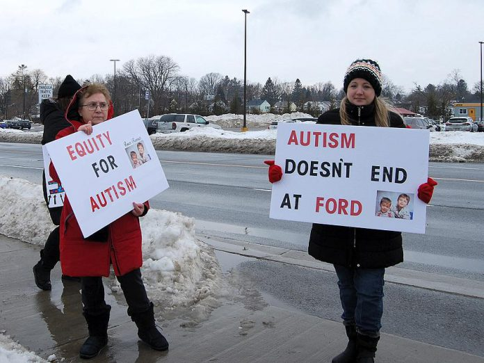 Lisa Devine (right), a mother of autistic twins, is supported by a family member at the  February 15, 2019 protest in Port Hope. (Photo: April Potter / kawarthaNOW.com)