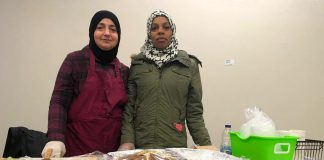 Two members of the Newcomer Kitchen in Peterborough on the first day at the winter location of the Peterborough Regional Farmers' Market in Peterborough Square. The market is donating vendor space for the group of Syrian refugees, who formed the Newcomer Kitchen to sell food including spinach pies, smoky baba ghanoush, and their very popular zaatar bread. (Photo courtesy of New Canadians Centre)