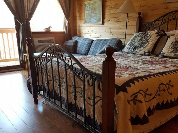 Popular with couples, Westwind Inn offers 35 cozy guest rooms with cedar-lined walls, antique furnishings, fireplaces, and more. (Photo courtesy of Westwind Inn)