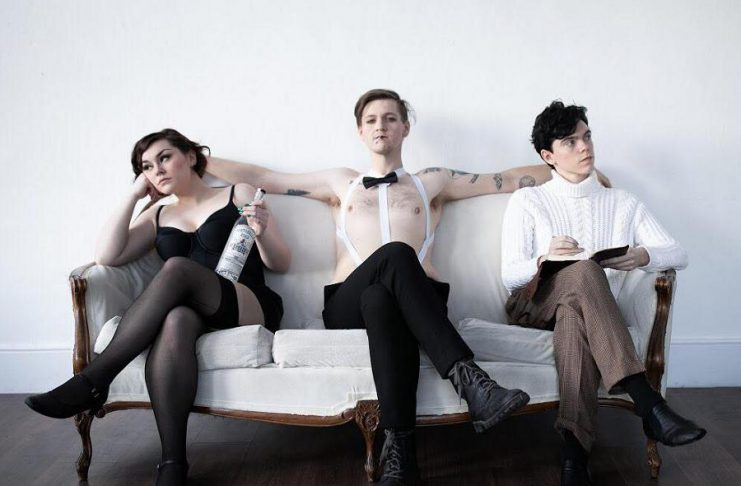"""Dani McDonald as Salli Bowles, Conner Clarkin as the Emcee, and Daze Francis as Cliff Bradshaw in a promotional photo for the Anne Shirley Theatre Company production of the classic musical """"Cabaret"""", which runs from March 15 to 23, 2019 at the Market Hall Performing Arts Centre. (Photo: Ash Naylor Photography)"""