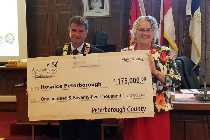 Hospice Peterborough executive director Linda Sunderland (right) accepting a cheque from Peterborough County Warden Joe Taylor in May 2018 for Hospice Peterborough's Every Moment Matters Campaign and the new Hospice Peterborough Care Centre. Sunderland is retiring from the organization after 26 years. (Photo: Hospice Peterborough)
