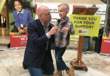 Peterborough Chamber of Commerce President and CEO Stu Harrison, who has been involved with the Easter Seals Telethon for 36 years, interviews the 2019 Ambassador Ryerson Beardmore on Wednesday (March 7th) at the Lansdowne Place kickoff announcement for the annual fundraiser, which takes place on Sunday, April 7th. Born with cerebral palsy, the 8-year0 old James Strath Public School student is now walking without the aid of assistive devices. (Photo: Paul Rellinger / kawarthaNOW.com)