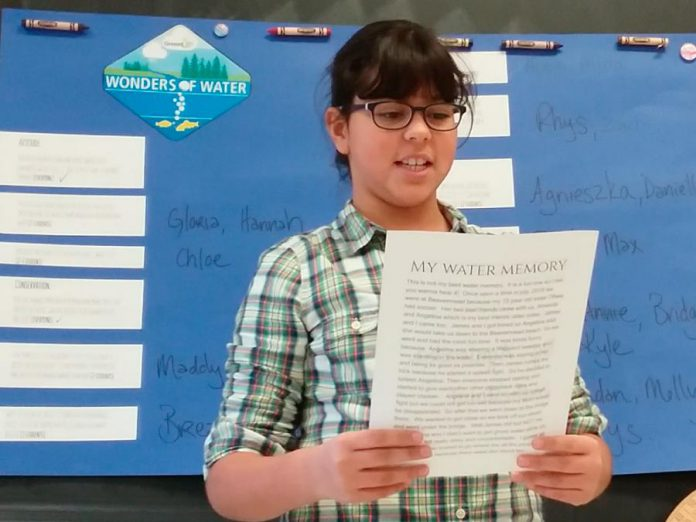 As part of the GreenUP Wonders of Water program, Agnieszka, a grade five student at Monsignor O'Donoghue in Peterborough presents her favourite water memory with her class and shares why she's grateful for water.  (Photo: Karen O'Krafka)