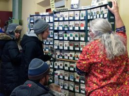 A vendor at last year's Seedy Sunday Peterborough help attendees select from a variety of organic vegetable and herb seeds. The 2019 event takes place on Sunday, March 10th from noon to 5 p.m. at Emmanuel East United Church. (Photo: Jillian Bishop)