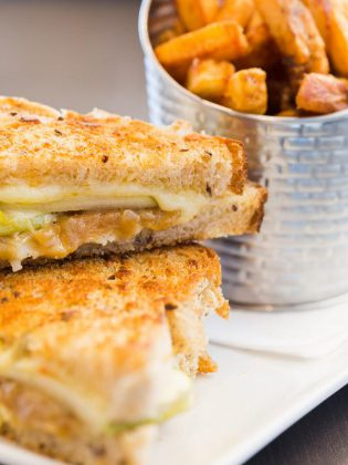 Sandwiches include a gourmet grilled cheese featuring locally made multigrain bread, brie, applewood smoked cheddar, fresh apple slices, and caramelized onions.  (Photo: Miranda Studios)