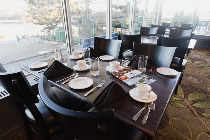The dining room at Riverside Grill Restaurant at Holiday Inn Peterborough-Waterfront has been freshly renovated, with large, bright windows offering a view of the water. (Photo: Miranda Studios)