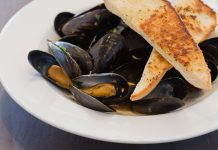 The recently renovated Riverside Grill Restaurant at Holiday Inn Peterborough-Waterfront in downtown Peterborough features a fresh new locally inspired menu that includes starters such as mussels steamed in Publican House beer. To celebrate the new menu, kawarthaNOW readers are eligible for a special deal for half-prized appetizers. (Photo: Miranda Studios)
