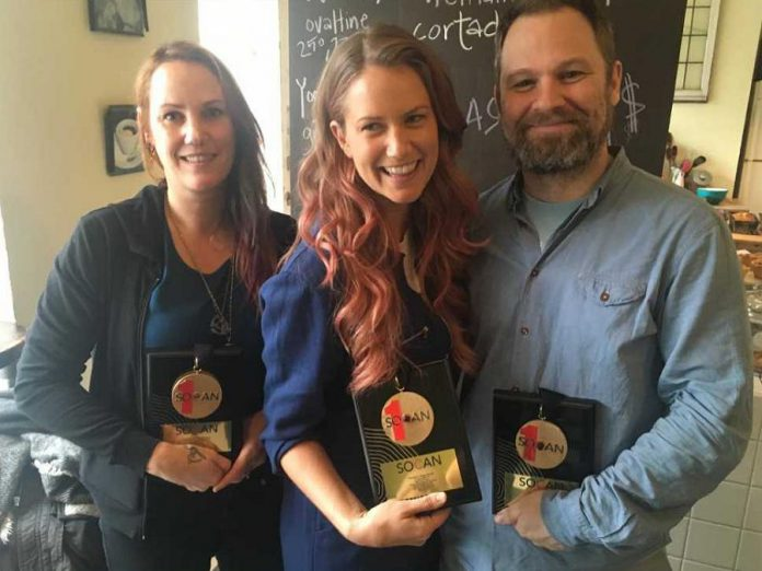 "Megan Bonnell (middle) with her SOCAN No. 1 Song Award for ""Separate Rooms"". Also pictured is producer Chris Stringer (right) and Amy Eligh of Arts & Crafts Music Publishing. (Photo: Melissa Cameron-Passley / SOCAN)"