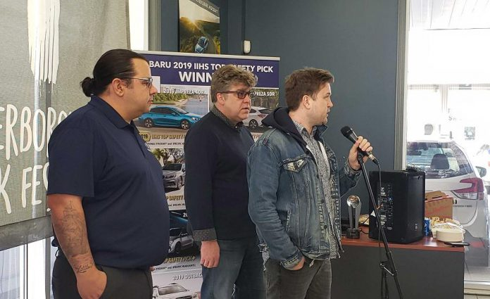 "Peterborough Folk Festival board vice chair and artistic director  Ryan Kemp (right) announces a partnership with Peterborough Subaru at the car dealership's showroom on Chemong Road on March 19, 2019.  Peterborough Subaru is sponsoring the 2019 Peterborough Folk Festival, which takes place for four days from August 15th to 18th.  The main stage at Nicholls Oval Park in East City will be called the ""Peterborough Subaru Stage"". Also pictured are Peterborough Subaru  sales and marketing specialist Phillip Jolicoeur (left) and Peterborough Folk Festival board chair Malcolm Byard.  (Photo: Jeannine Taylor / kawarthaNOW.com)"