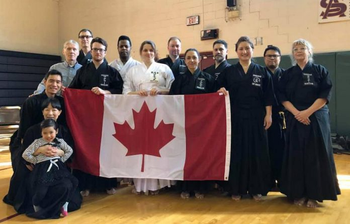 Warren Wagler (holding the Canadian flag at left) is the youngest member of Team Canada Iaido, which competed at the 2019 East Coast Iaido Taikai (competition) held in Jersey City, New Jersey on February 17, 2019. (Photo courtesy of  Team Canada Iaido)