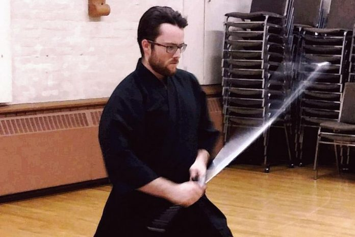 Warren Wagler practising the traditional Japanese martial art of iaido (drawing and cutting with a samurai sword). The Oshawa native, who is a member of  Kenshokan Dojo with locations in Peterborough, Oshawa, Tweed, and Lindsay, won gold in the  sandan (third dan) division at the 2019 East Coast Iaido Taikai (competition) held in Jersey City, New Jersey on February 17, 2019. (Photo courtesy of Team Canada Iaido)