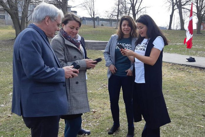 Selwyn Township mayor Andy Mitchell, Peterborough mayor Diane Therrien, and Peterborough-Kawartha MP Maryam Monsef (right) explore the Random Acts of Green mobile app as the social enterprise's founder and CEO Jessica Correa looks on, at the April 18, 2019 announcement of $200,000 in federal funding from the Climate Action Fund. The funding will help Random Acts of Green to develop and promote the mobile app, which measures and rewards Canadians for their 'green acts' to reduce greenhouse gas emissions. (Photo: Office of Andy Mitchell)