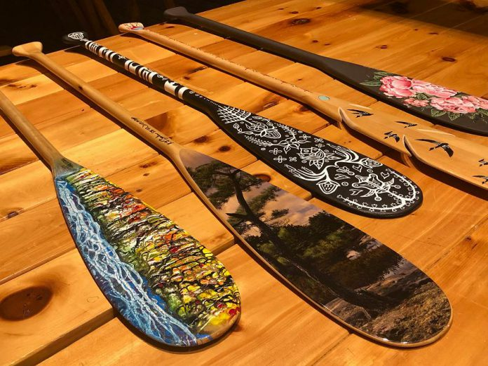 Dr. Roberta Bondar, Canada's first female astronaut, has created and donated a paddle (second from left) for the Campfires & Cocktails fundraiser, which takes place at The Canadian Canoe Museum on May 4, 2019. Also pictured are paddles created (from left to right) by Robert Atyeo, Tia Cavanagh, Randall Knott, and Robyn Jenkins. A total of 14 paddles, as well as cedar-strip canoe constructed by the late Lakefield boat builder Walter Walker, will be auctioned off during the event, with proceeds supporting the museum's educational and public programs. (Photo courtesy of The Canadian Canoe Museum)