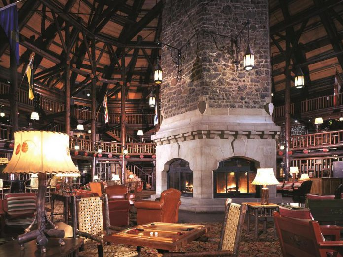 The Quebec Resort Getaway includes a night at Le Château Montebello, the largest log building in the world. Pictured is the hotel lobby, which features a three-storey atrium built around a massive stone fireplace with a 20-metre chimney. (Photo: Fairmont Le Château Montebello)