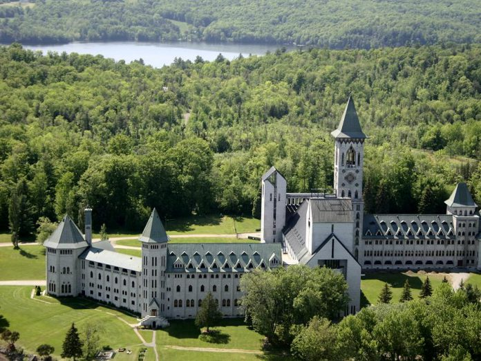 Located in the Eastern Townships on the west shore of Lake Memphrémagog in Quebec, Abbaye de Saint-Benoît-du-Lac is a Benedictine community founded in 1912 by French monks. The monks have a cheese factory, two orchards, a cider mill, and a shop where all their products are sold. (Photo: Destination Sherbrooke)