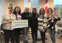 Staff and board members of the Elizabeth Fry Society of Peterborough pose with Maryam Monsef, Minister of International Development and Minister for Women and Gender Equality and Minister of International Development and Minister for Women and Gender Equality and Peterborough—Kawartha MP, on April 26, 2019 following an announcement of federal funding.. The organization is one of six women's oroganizations in Ontario that are receiving funding under the Government of Canada's Capacity-building Fund. From left to right: board chair Frances Wilbur, Minister Maryam Monsef, board member Marlis Lindsay, board treasurer Mary Goddard, executive director Debbie Carriere, and board member Emily Rashotte with Clive. (Photo: Elizabeth Fry Society of Peterborough / Facebook)