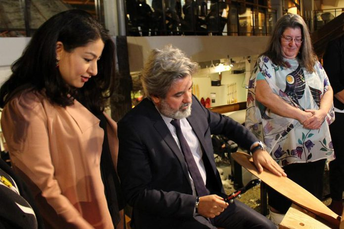 Minister of Canadian Heritage and Multiculturalism Pablo Rodriguez tries his hand at paddle carving at The Canadian Canoe Museum on Monaghan Road in Peterborough on April 1, 2019, as Peterborough-Kawartha MP Maryam Monsef (left) looks on. The Government of Canada announced a $10 million investment from the Canada Cultural Spaces Fund for the contruction of a new museum facility. (Photo courtesy of The Canadian Canoe Museum)
