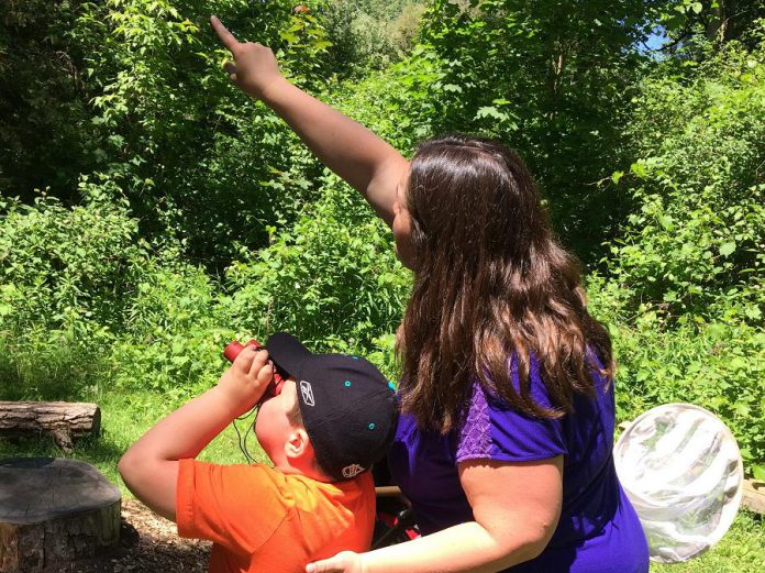 Attendees of the 2018 Ecology Park BioBlitz enjoy birdwatching for the first time. There's no need to head off into the wilderness to get your does of nature: it can happen in your own backyard or in a neighbourhood park. (Photo courtesy of GreenUP)