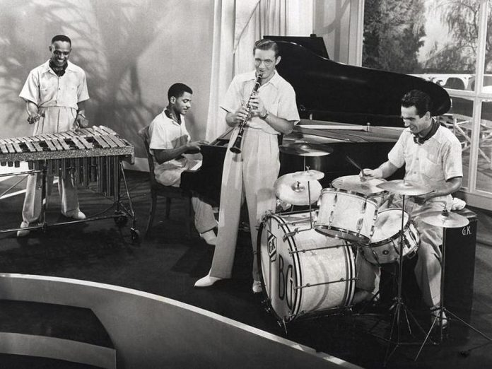 "The jazz music genre has been a socially unifying force. In 1936, clarinetist Benny Goodman (second from right) formed a racially integrated jazz quartet with vibraphonist Lionel Hampton, pianist Teddy Wilson, and drummer Gene Krupa.   ""I never thought it was brave.  That was the way it was supposed to be.  How can you play if you're going to worry about a guy's color?  It's tough enough just to play,"" Goodman said. (Photo: Pictorial Press Ltd.)"