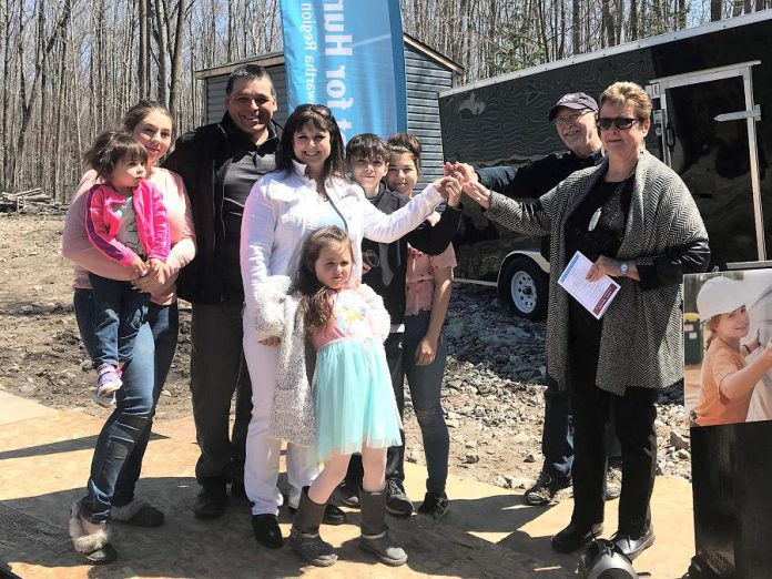The Jacobs family receiving the keys to their new home from Curve Lake First Nation Chief Phyllis Williams and Habitat for Humanity Peterborough & Kawartha Region during a dedication ceremony at  Curve Lake First Nation on April 28, 2019. (Photo courtesy of Habitat for Humanity Peterborough & Kawartha Region)