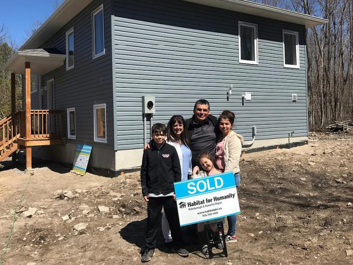 Members of the Jacobs family in front of their new home at 76 Quinquish Road in Curve Lake on April 28, 2019. The home was made possible through a partnership between Curve Lake First Nation and Habitat for Humanity Peterborough & Kawartha Region. (Photo courtesy of Habitat for Humanity Peterborough & Kawartha Region)