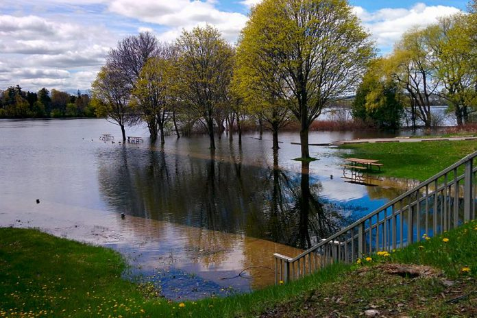 In 2017, Little Lake rose above the retaining walls and flooded the parking lot at Ashburnham Lock 20 at Beavermead Park in Peterborough. While water levels are not yet this high, the City of Peterborough remains under a flood warning as water levels will continue to rise along the Kawartha Lakes and Otonabee River and 25 to 45 millimetres of rain is forecast for Friday. (Photo: Bruce Head / kawarthaNOW)