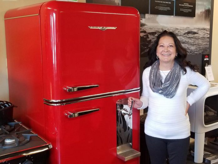 Owner of The Original Flame, Michele Kadwell-Chalmers, can assist anyone looking to add an instant dose of vintage glam to their home or business with the most enduringly popular designs dating back decades, like this red Northstar fridge with a draft beer dispenser in the door. (Photo courtesy of The Original Flame)