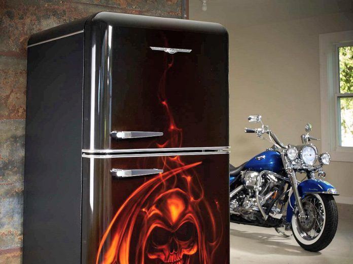 The retro appliance trend extends beyond the 1950s-style look: a motorcyclist requested this custom black fridge with a skeleton and flames.  (Photo courtesy of Elmira Stove Works)